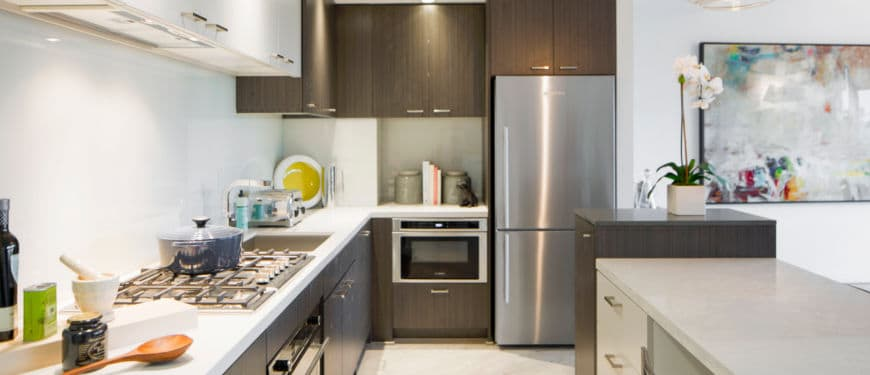 The Hepburn : Designed for both beauty and function, the kitchen shows off sleek, stylish efficiency while concealing essential utility and features.