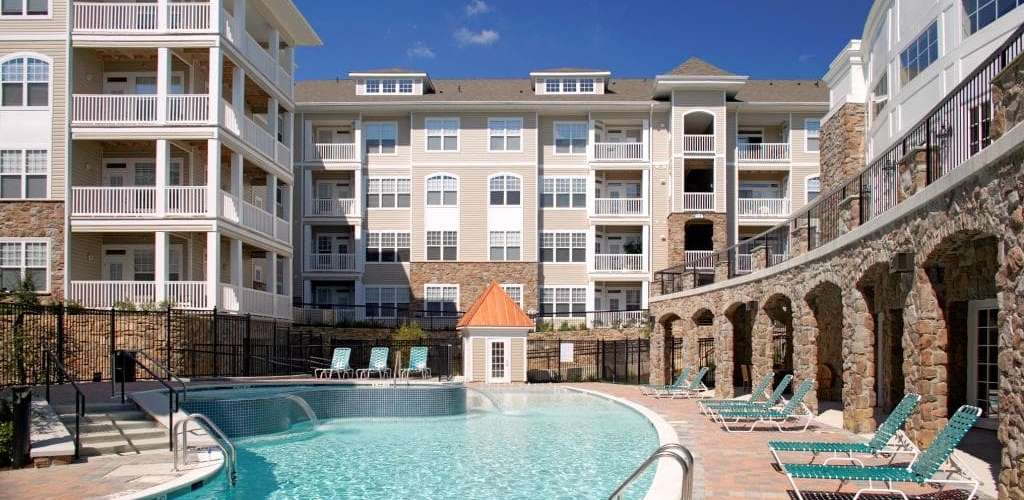 Stone Point Apartments : Cool off in the large pool with your friends
