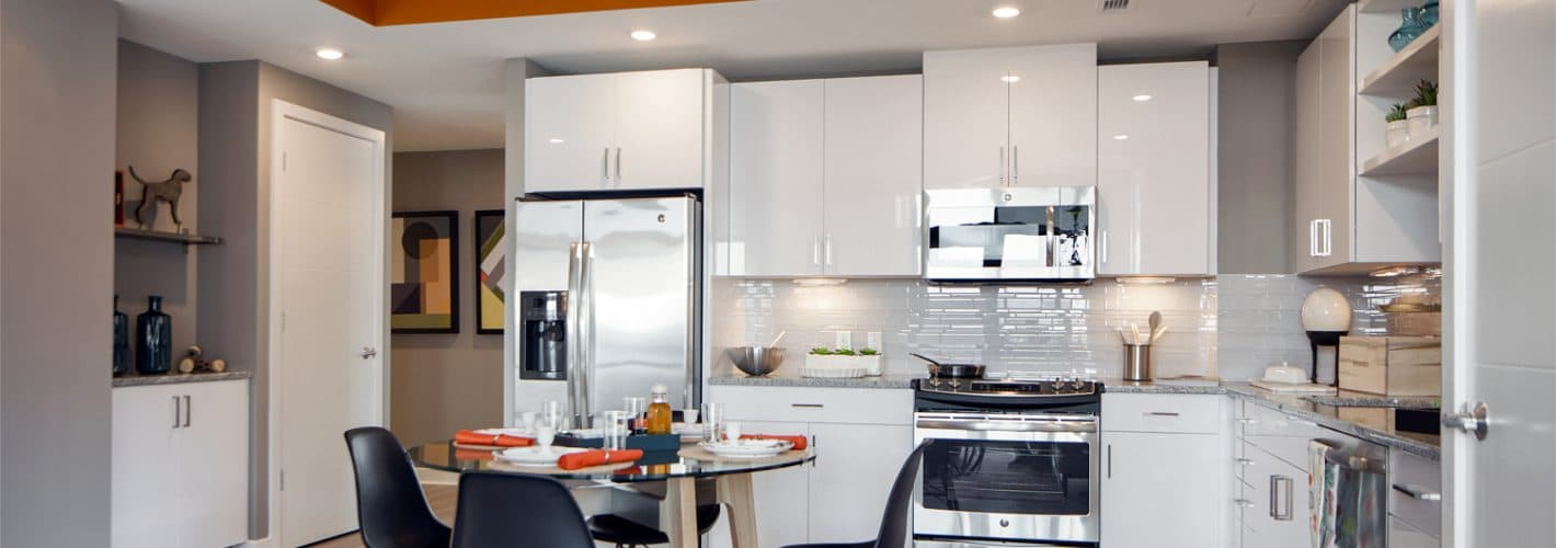 Insignia on M : Stunning kitchens with designer white cabinetry with pantries and under-counter lighting.