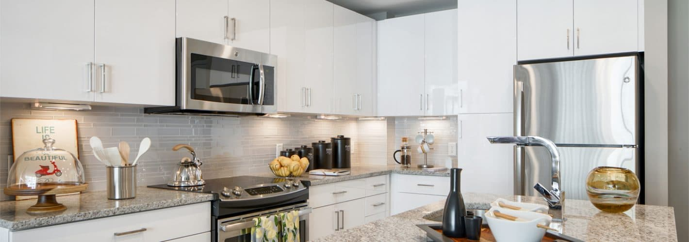 Insignia on M : Cook and entertain in our gourmet kitchens with stone countertops, glass-tile backsplashes, and stainless steel GE®  ENERGY STAR® appliances.