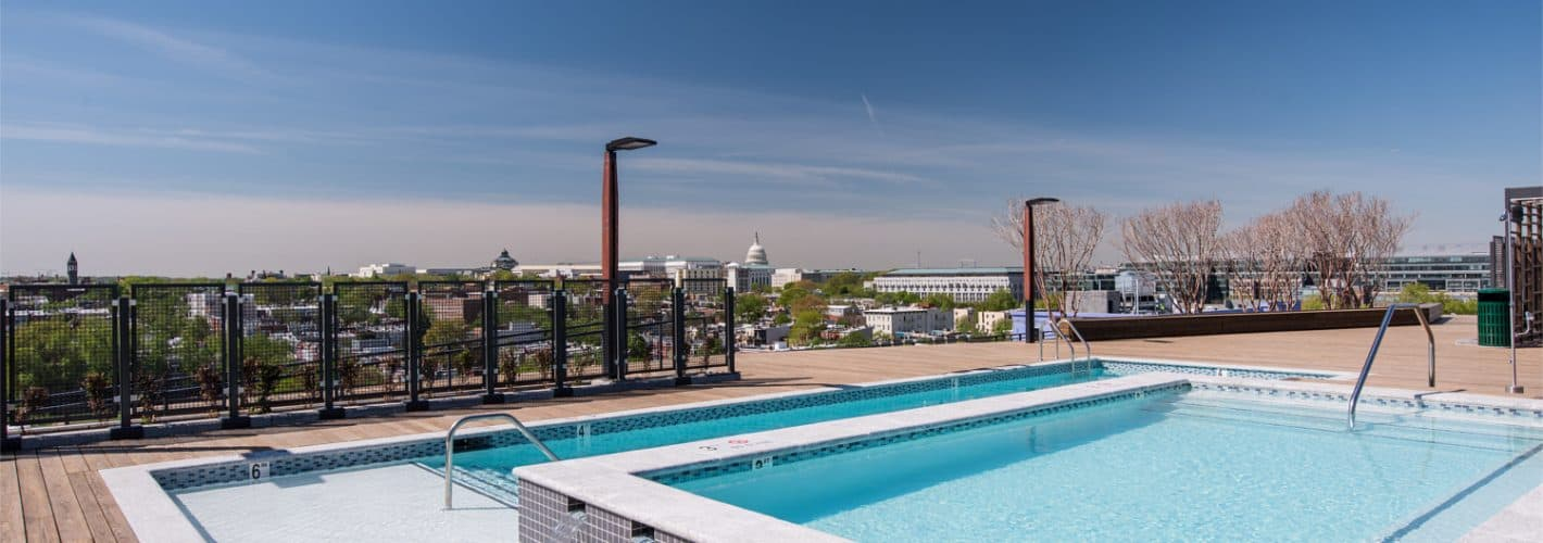 The Apollo : Rooftop pool deck with elevated two-level pool and shade trellis