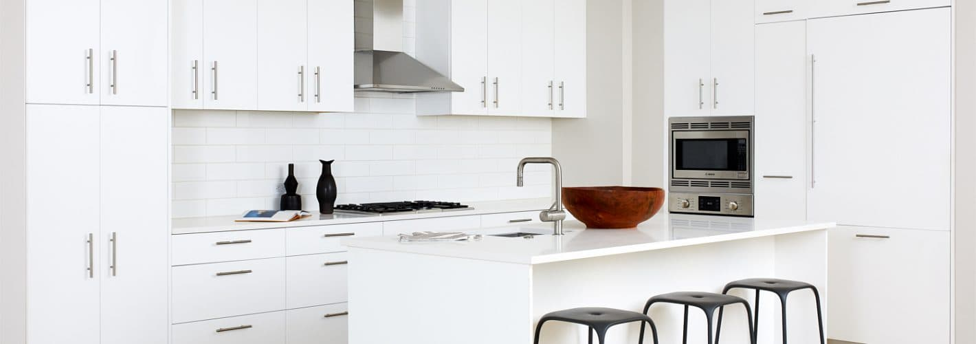 The Residences at Eastern Market : Savor european-inspired, all white flat-front wood cabinets.
