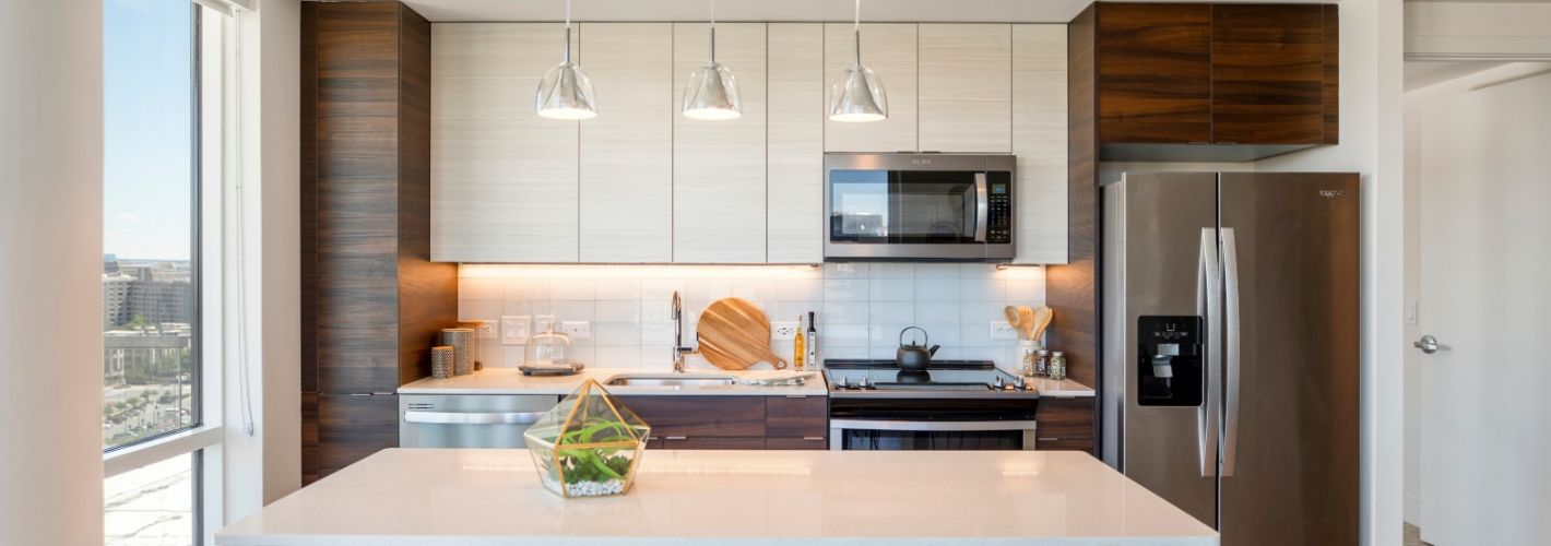 The Witmer : Darkwood cabinets and white granite on stainless steel