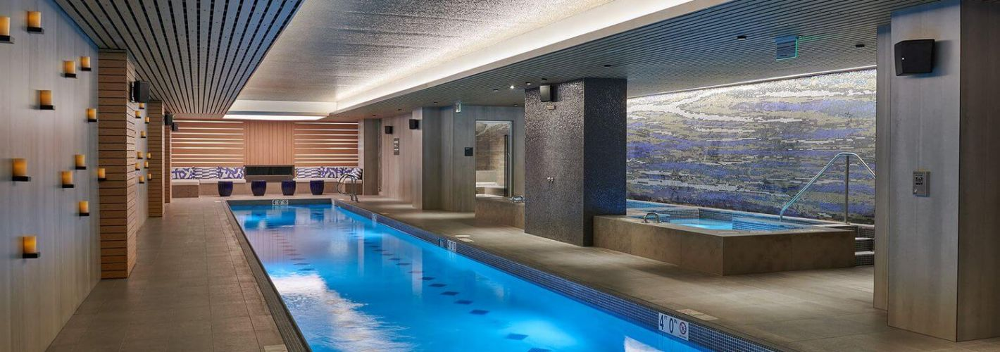 Crossing : RELAXATION MODE: Our lavish Wellness Suite includes a lap pool with underwater speakers, jacuzzi, sauna, steam room, cold plunge, treatment rooms, and locker rooms.