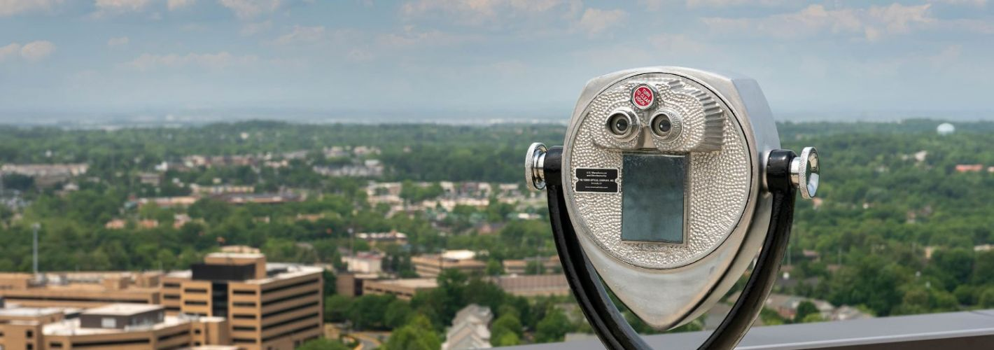 Signature at Reston Town Center : Explore the reaches of Northern Virginia's skyline through a pair of vintage binoculars
